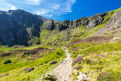Path, lake and mountains, Cwm Idwal and the Devil's Kitchen. Royalty Free Stock Images