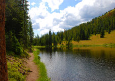 Path by a Lake in the Rockies Stock Photography