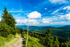Path leading down from tableland Labska Louka. In Giant Mountains & x28;Krkonose& x29;. On background there are nice scenery with mountains, hills, trees Royalty Free Stock Photo