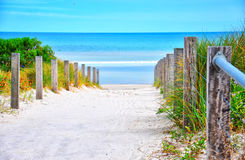 Path leading down to the beach. On sunny summer day stock photo
