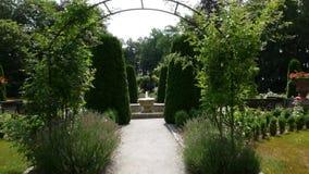 Path leading through the garden arcade. Chateau park stock footage