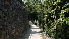 Path leading through the garden arcade. Walk around the castle wall stock video footage