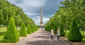 Path leading to Nelson`s Monument in Glasgow Green, Scotland. Glasgow Green is a park in the east end of Glasgow, Scotland on the north bank of the River Clyde Royalty Free Stock Photos