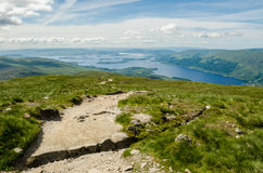 Path leading to the top of Ben Lomond in a sunny  day. Loch Lomo Royalty Free Stock Image
