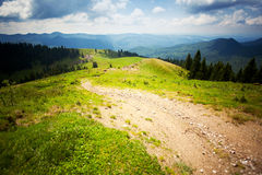 Path leading to valley. And mountains Stock Photos