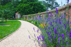 Path Leads past Flowers in Mount Vernon Stock Photo