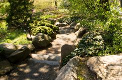 Path lined by rocks in a garden. /wilderness Royalty Free Stock Photo