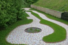 The path is lined with stone tiles stock photos