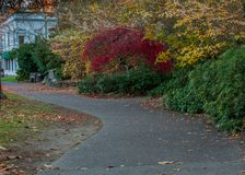 Path at Lithia park entrance side facing main street. In Ashland, Oregon, USA, featuring red and yellow colors in the Autumn royalty free stock images