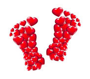 The path ... of love. Shaped feet with hearts Stock Photography
