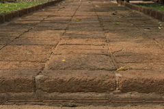 Path made of laterite. Paths are made of laterite pavement to the old temple Royalty Free Stock Image