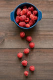 Path made from raspberries to small ceramic bowl full of red raspberries Royalty Free Stock Images