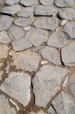 The path is made of stone. Path from large stacked cobblestones Stock Photo