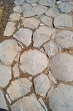 The path is made of stone. Path from large stacked cobblestones Royalty Free Stock Photography