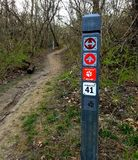 Path marker in a park. Path, trail marker in a forest preserve for hiking and biking in Chicago area, early spring. This trail is very well marked giving a Royalty Free Stock Image