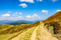 Path through a meadows of mountain ridge Royalty Free Stock Photos