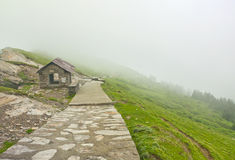 Path in misty mountains Stock Photography