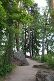 The path in the Monrepo Park in Vyborg. Royalty Free Stock Images