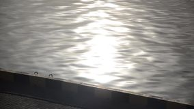 The path of the morning sun is reflected in the sea. stock footage