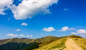 Path through the mountain ridge in summer Royalty Free Stock Photography