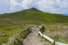 Path in mountains in Poland - Bieszczady. Beautiful, peaceful, green mountains in Poland - Bieszczady during summer Stock Image