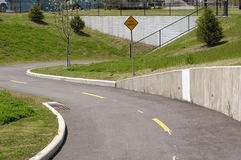 Path Narrows. Bike path leading to tunnel where path narrows Royalty Free Stock Photos