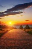 Path near the sea at sunset Stock Image