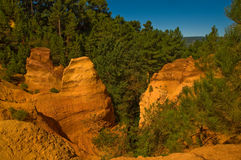 The path of the ochre near Roussillon,France. Near Roussillon,Vaucluse,France,a touristic path has taken the place of an ancient quarry of ochre stock photos
