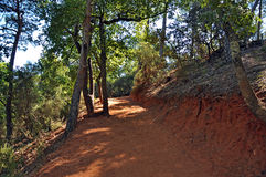 The path of the ochre near Roussillon,France. Near Roussillon,Vaucluse,France,a touristic path has taken the place of an ancient quarry of ochre royalty free stock image