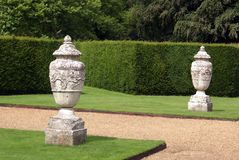 Path with ornamental urns and hedge Stock Images