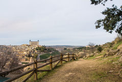 A path over the hill vith a view to Toledo Alcazar, evening at surroundings of Toledo Stock Photography