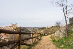 A path over the hill vith a view to Toledo Alcazar, evening at surroundings of Toledo Stock Images