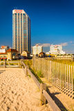 Path over sand dunes and buildings along the boardwalk in Atlantic City, New Jersey. stock photo