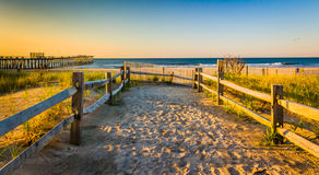 Path over sand dunes to the Atlantic Ocean at sunrise in Ventnor Stock Photo