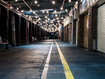 Path with Overhead Lights Outside Closed Market Stock Image