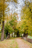 Path in a park  in the Netherlands at Autumn. Walking Path And Fence in a park Along A Castle in the Netherlands at Autumn Stock Photos
