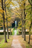Path in a park  in the Netherlands at Autumn. Walking Path And Fence in a park Along A Castle in the Netherlands at Autumn Stock Photography