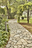 Path in the park, paved with stone tiles. Track in the summer the park, paved with stone tiles, beautiful romantic corner Stock Photo