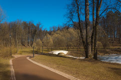 Path in park in the spring afternoon. Path in park in the clear spring afternoon Stock Photos