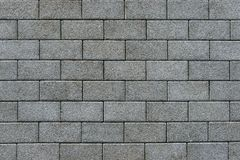 Pavement paved with gray rectangular brick. The path is paved with gray rectangular dirty brick Royalty Free Stock Images