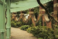 Path Through Pergola in Walled Garden stock photo