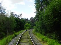 The path of the railway. The railway passes through beautiful landscapes.  Details and close-up. royalty free stock photo