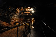 Path in Red cave (Kizilkoba),Crimea,Ukraine. Path in Red cave (Kizilkoba),the biggest Crimea cave,Ukraine Stock Image