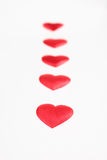 Path from red silk hearts Stock Images
