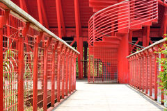Path and revolving ladder in red. Path and revolving ladder with metal handrail in red, shown as composition by shape and line with rhythm, and architecture Stock Image