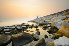 Path on the rock beach at sunrise Royalty Free Stock Images