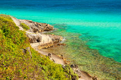 Path in the rocks near caribbean sea. Royalty Free Stock Photography