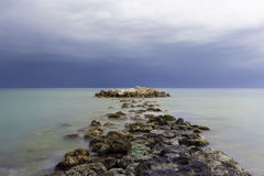 Path of rocks on water. Path of rocks over water to the horizon Stock Photos