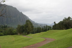 Path through Rolling Hills towards Mountains Royalty Free Stock Photos