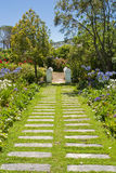 Path running through colourful garden Royalty Free Stock Photography